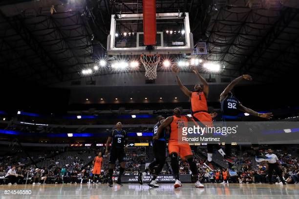DerMarr Johnson of 3s Company attempts a shot while being guarded by Deshawn Stevenson of Power during week six of the BIG3 three on three basketball...