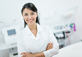 Woman dermatologist looking happy working at a spa or practice