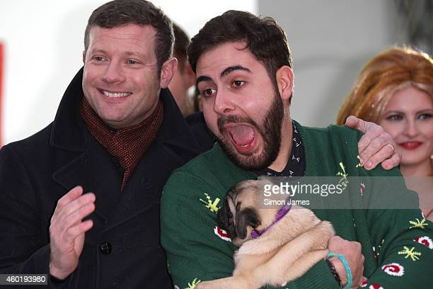 Dermot O'Leary and X Factor finalist Andrea Faustini sighting in Leicester square on December 9 2014 in London England