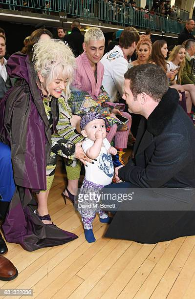 Dermot O'Leary meets Jaime Winstone and baby Ray at the Vivienne Westwood show during London Fashion Week Men's January 2017 collections at Seymour...
