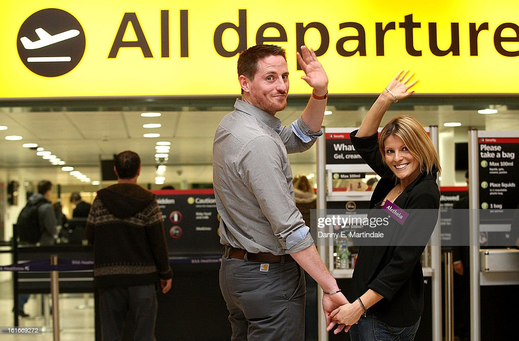 Dermot Skinnader (L) and Aletheia Hunn go through the departures gate after they picked each other to go on a blind date trip to LA at Heathrow Airport on February 14, 2013 in London, England. Claudia Winkleman hosted the UK's first ever live dating show on Valentine's Day with the prize being a trip in Air New Zealand's economy skycouch to LA.