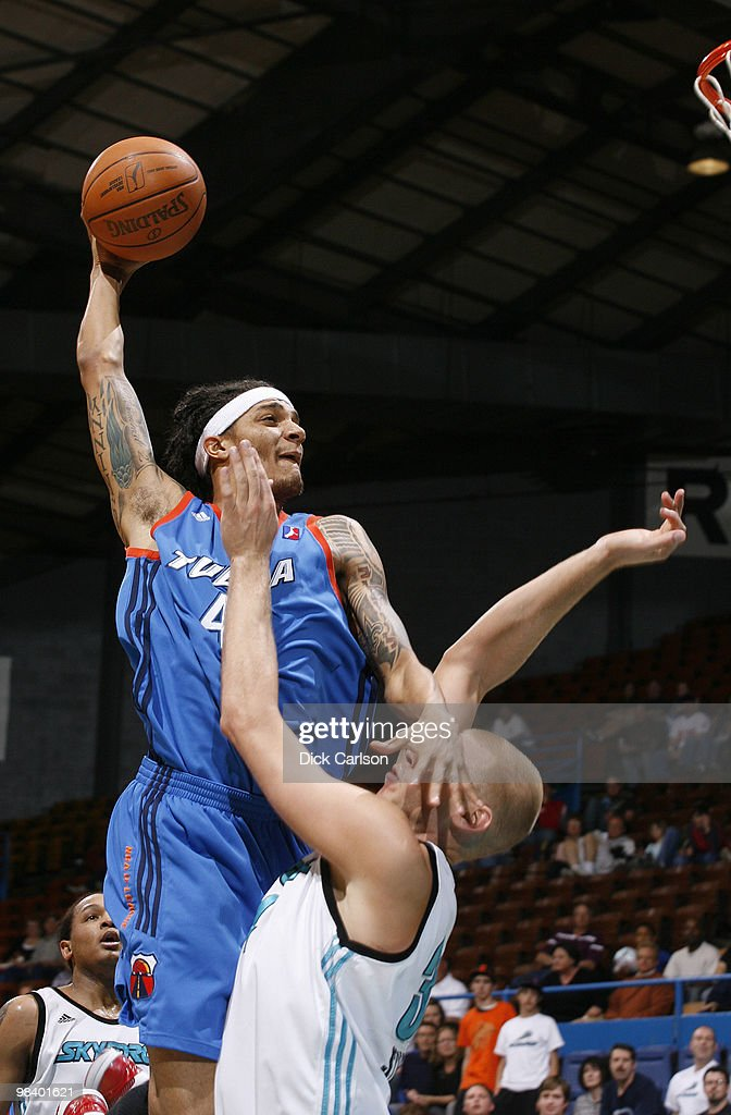 Deron Washington of the Tulsa 66ers goes for a dunk over Greg Stiemsma of the Sioux Falls Skyforce during their NBA DLeague playoff game April 11...
