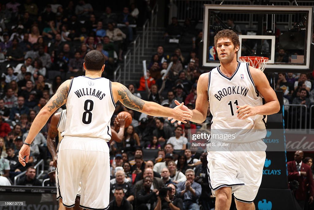 Deron Williams #8 and Brook Lopez #11 of the Brooklyn Nets congratulate each other during a game played against the Sacramento Kings on January 5, 2013 at the Barclays Center in the Brooklyn borough of New York City.