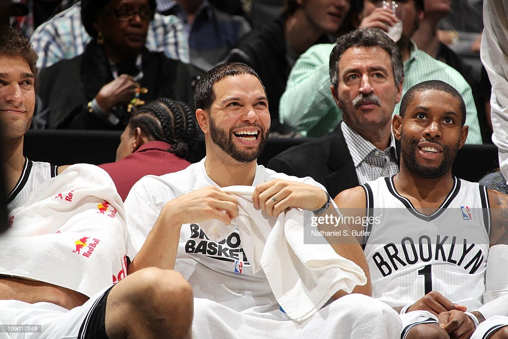 <a gi-track='captionPersonalityLinkClicked' href=/galleries/search?phrase=Deron+Williams&family=editorial&specificpeople=203215 ng-click='$event.stopPropagation()'>Deron Williams</a> #8 and <a gi-track='captionPersonalityLinkClicked' href=/galleries/search?phrase=C.J.+Watson&family=editorial&specificpeople=740190 ng-click='$event.stopPropagation()'>C.J. Watson</a> #1 of the Brooklyn Nets smile during the game against the Sacramento Kings on January 5, 2013 at the Barclays Center in the Brooklyn borough of New York City.