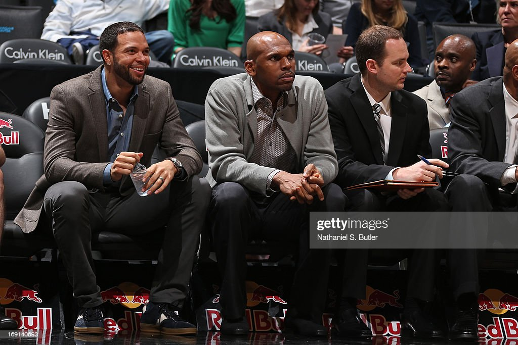 Deron Williams #8 and Jerry Stackhouse #42 of the Brooklyn Nets look on from the bench during the game against the Washington Wizards on April 15, 2013 at the Barclays Center in the Brooklyn borough of New York City.
