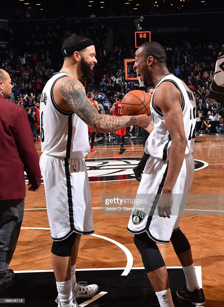 <a gi-track='captionPersonalityLinkClicked' href=/galleries/search?phrase=Deron+Williams&family=editorial&specificpeople=203215 ng-click='$event.stopPropagation()'>Deron Williams</a> #8 and <a gi-track='captionPersonalityLinkClicked' href=/galleries/search?phrase=Markel+Brown&family=editorial&specificpeople=7542399 ng-click='$event.stopPropagation()'>Markel Brown</a> #22 of the Brooklyn Nets smile after the win against the Toronto Raptors at Barclays Center on April 3, 2015 in Brooklyn, New York