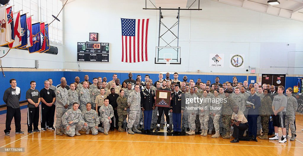 Deron Williams #8 and the Brooklyn Nets pose for a team picture during a team event in celebration of Veterans Day at Ft. Hamilton, Brooklyn on November 11, 2013 in the Brooklyn borough of New York City.