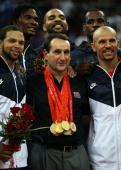Deron Williams Chris Bosh Carlos Boozer Le Bron James and Jason Kidd of the United States pose for photos with head coach Mike Krzyzewski after...