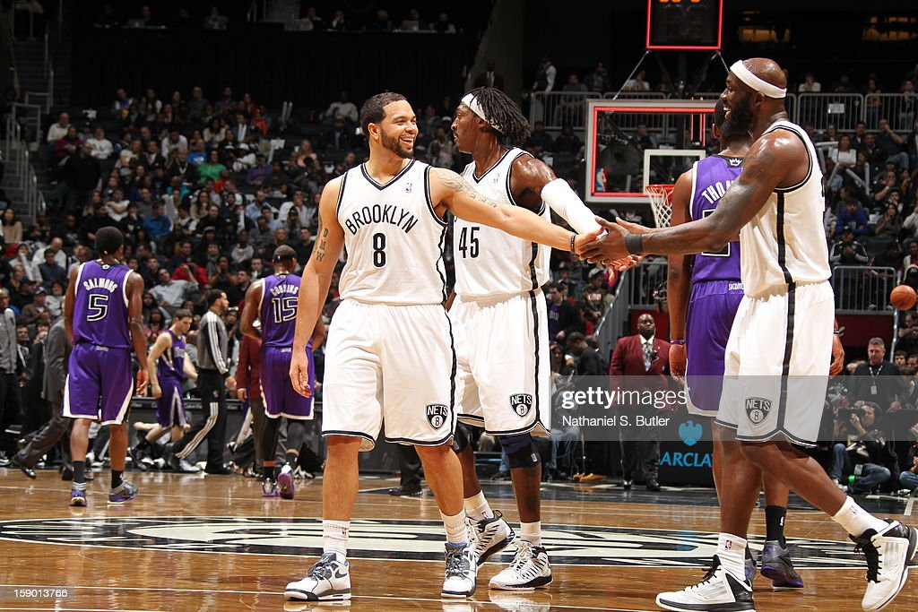 Deron Williams #8, Gerald Wallace #45 and Reggie Evans #30 of the Brooklyn Nets congratulate each other during the game against the Sacramento Kings on January 5, 2013 at the Barclays Center in the Brooklyn borough of New York City.