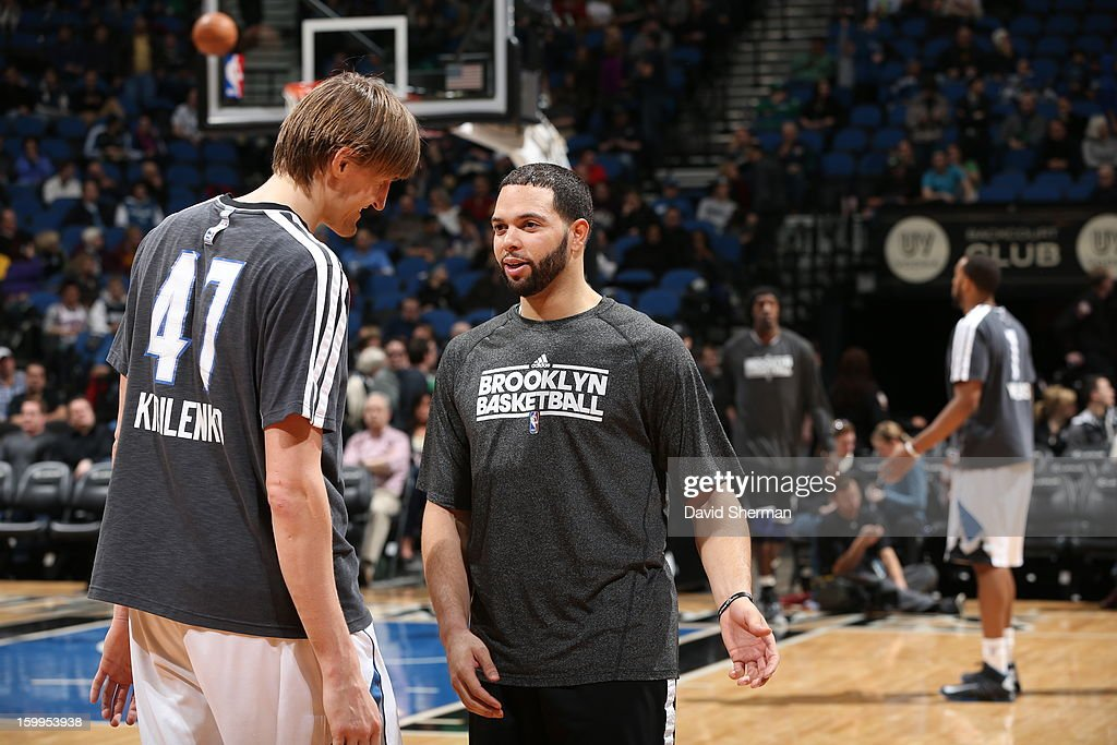 Deron Williams #8 of the Brooklyn Nets and Andrei Kirilenko #47 of the Minnesota Timberwolves confer during the game between the Minnesota Timberwolves and the Brooklyn Nets on January 23, 2013 at Target Center in Minneapolis, Minnesota.
