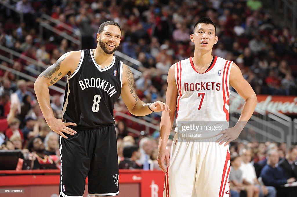 Deron Williams #8 of the Brooklyn Nets and Jeremy Lin #7 of the Houston Rockets look on during a break in play on January 26, 2013 at the Toyota Center in Houston, Texas.