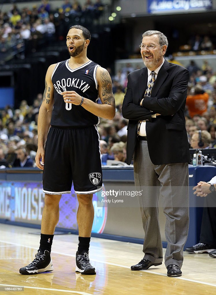 Deron Williams # 8 of the Brooklyn Nets and P.J. Carlesimo the head coach watch the action during the game against the Indiana Pacers at Bankers Life Fieldhouse on April 12, 2013 in Indianapolis, Indiana.