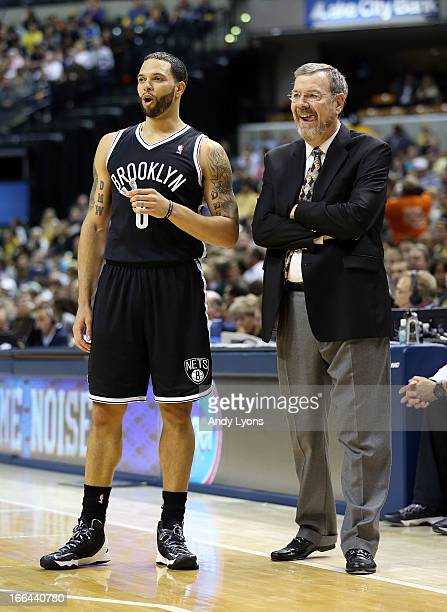 Deron Williams of the Brooklyn Nets and PJ Carlesimo the head coach watch the action during the game against the Indiana Pacers at Bankers Life...