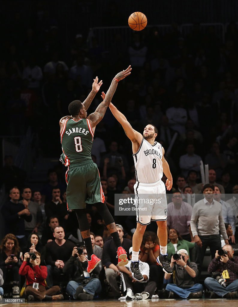 <a gi-track='captionPersonalityLinkClicked' href=/galleries/search?phrase=Deron+Williams&family=editorial&specificpeople=203215 ng-click='$event.stopPropagation()'>Deron Williams</a> #8 of the Brooklyn Nets attempts to block a shot by Larry Sanders #8 of the Milwaukee Bucks at the Barclays Center on February 19, 2013 in New York City.