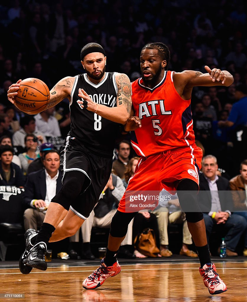 <a gi-track='captionPersonalityLinkClicked' href=/galleries/search?phrase=Deron+Williams&family=editorial&specificpeople=203215 ng-click='$event.stopPropagation()'>Deron Williams</a> #8 of the Brooklyn Nets attempts to drive past <a gi-track='captionPersonalityLinkClicked' href=/galleries/search?phrase=DeMarre+Carroll&family=editorial&specificpeople=784686 ng-click='$event.stopPropagation()'>DeMarre Carroll</a> #5 of the Atlanta Hawks during the first round of the 2015 NBA Playoffs at Barclays Center on April 25, 2015 in the Brooklyn borough of New York City.