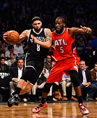 Deron Williams of the Brooklyn Nets attempts to drive past DeMarre Carroll of the Atlanta Hawks during the first round of the 2015 NBA Playoffs at...