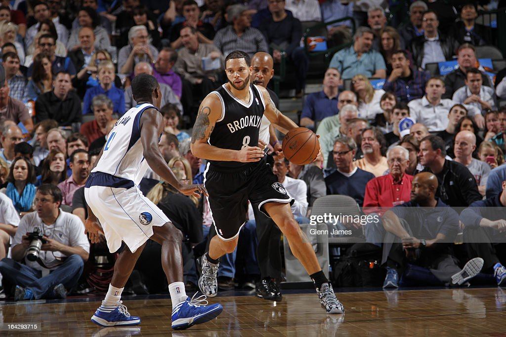 <a gi-track='captionPersonalityLinkClicked' href=/galleries/search?phrase=Deron+Williams&family=editorial&specificpeople=203215 ng-click='$event.stopPropagation()'>Deron Williams</a> #8 of the Brooklyn Nets brings the ball up court against the Dallas Mavericks on March 20, 2013 at the American Airlines Center in Dallas, Texas.