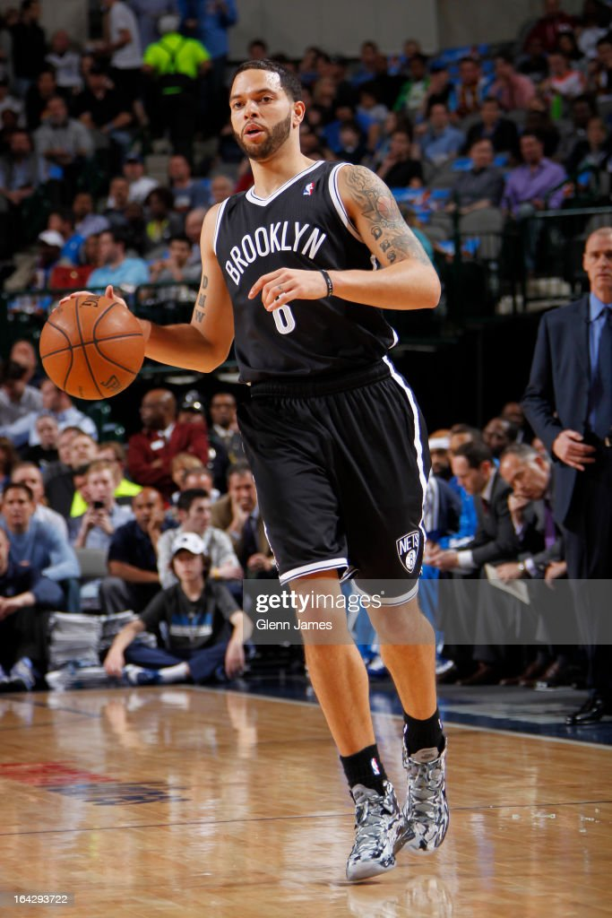 Deron Williams #8 of the Brooklyn Nets brings the ball up court against the Dallas Mavericks on March 20, 2013 at the American Airlines Center in Dallas, Texas.