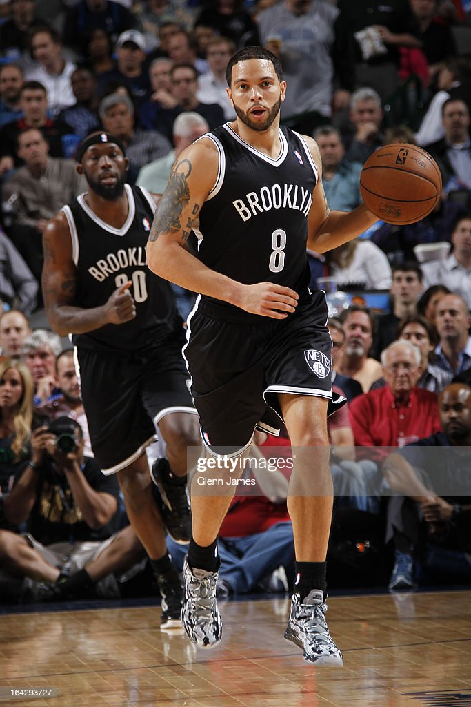 Deron Williams #8 of the Brooklyn Nets brings the ball up court during the game against the Dallas Mavericks on March 20, 2013 at the American Airlines Center in Dallas, Texas.