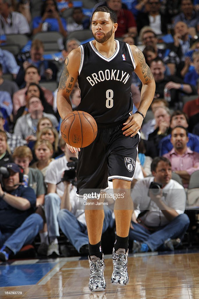 <a gi-track='captionPersonalityLinkClicked' href=/galleries/search?phrase=Deron+Williams&family=editorial&specificpeople=203215 ng-click='$event.stopPropagation()'>Deron Williams</a> #8 of the Brooklyn Nets brings the ball up court during the game against the Dallas Mavericks on March 20, 2013 at the American Airlines Center in Dallas, Texas.