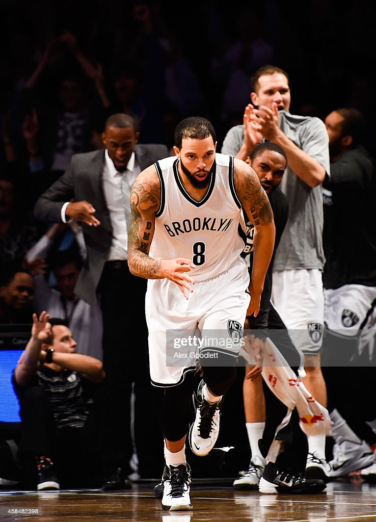 Deron Williams #8 of the Brooklyn Nets celebrates a three-point shot in the second half during a game against the Minnesota Timberwolves at the Barclays Center on November 5, 2014 in the Brooklyn borough of New York City.