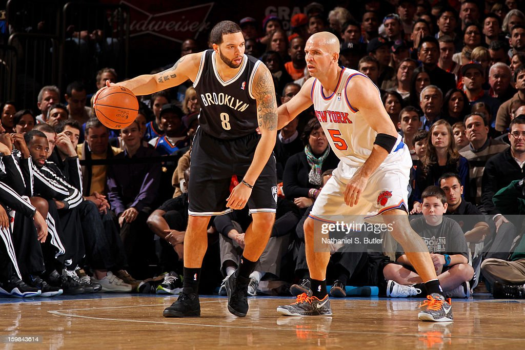 Deron Williams #8 of the Brooklyn Nets controls the ball against Jason Kidd #5 of the New York Knicks on January 21, 2013 at Madison Square Garden in New York City.