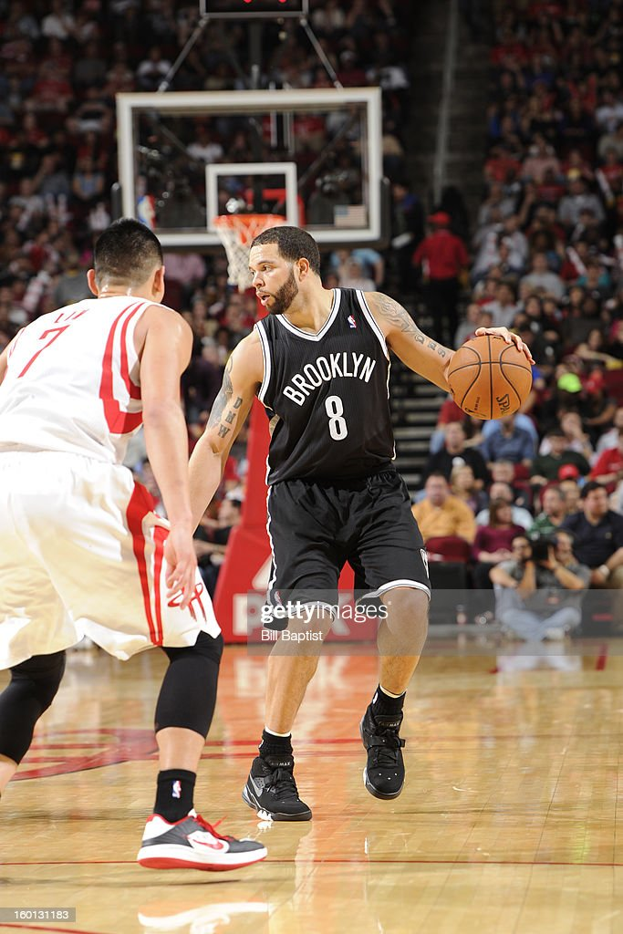 Deron Williams #8 of the Brooklyn Nets controls the ball against Jeremy Lin #7 of the Houston Rockets on January 26, 2013 at the Toyota Center in Houston, Texas.