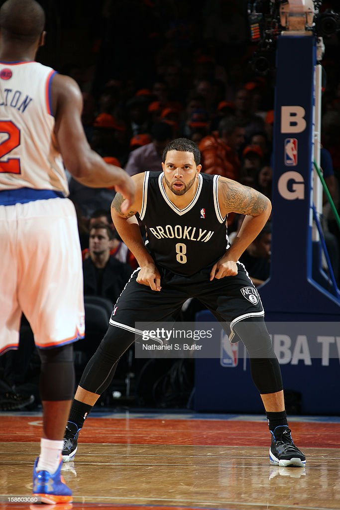 <a gi-track='captionPersonalityLinkClicked' href=/galleries/search?phrase=Deron+Williams&family=editorial&specificpeople=203215 ng-click='$event.stopPropagation()'>Deron Williams</a> #8 of the Brooklyn Nets defends against the New York Knicks on December 19, 2012 at Madison Square Garden in New York City.