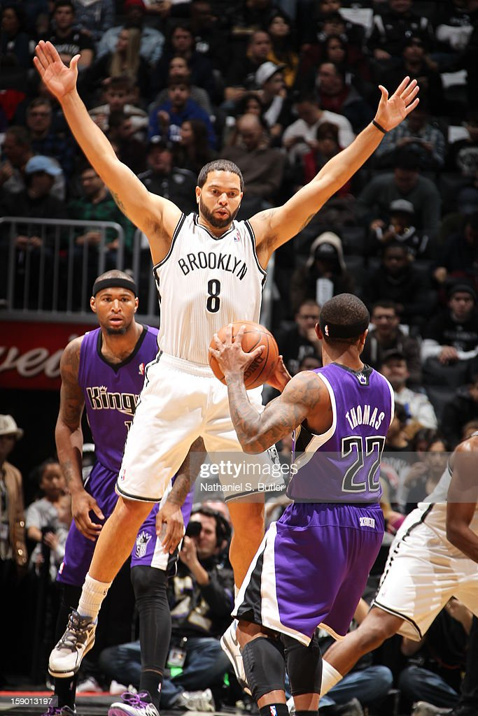 Deron Williams #8 of the Brooklyn Nets defends Isaiah Thomas #22 of the Sacramento Kings on January 5, 2013 at the Barclays Center in the Brooklyn borough of New York City.