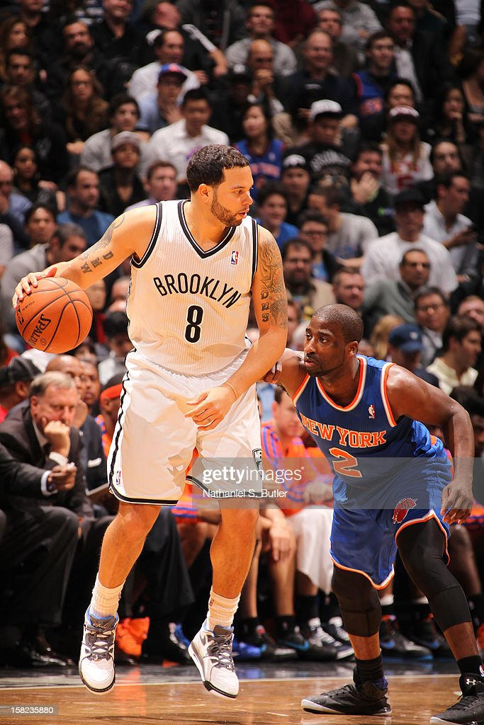 Deron Williams #8 of the Brooklyn Nets dribbles against Raymond Felton #2 of the New York Knicks on December 11, 2012 at the Barclays Center in the Brooklyn borough of New York City.
