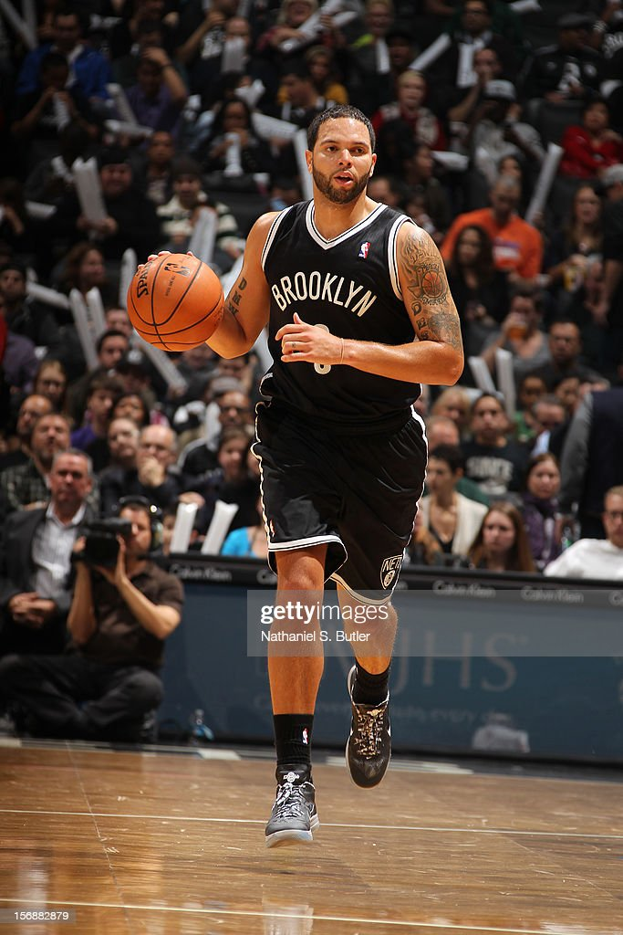 Deron Williams #8 of the Brooklyn Nets dribbles against the Los Angeles Clippers on November 23, 2012 at the Barclays Center in the Brooklyn Borough of New York City.