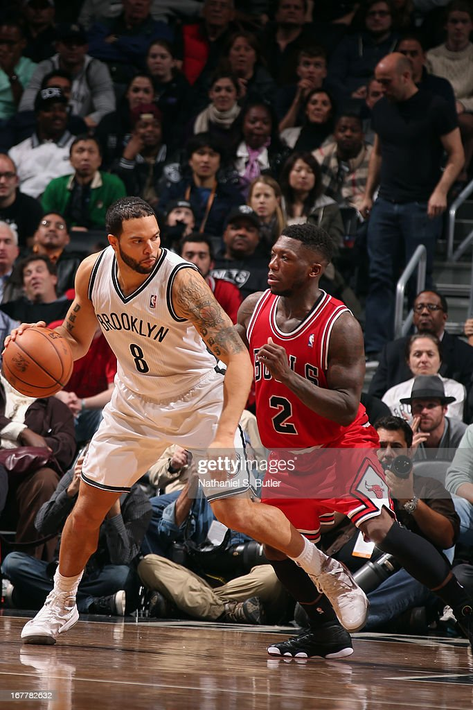 Deron Williams #8 of the Brooklyn Nets dribbles the ball against Nate Robinson #2 of the Chicago Bulls in Game Five of the Eastern Conference Quarterfinals during the 2013 NBA Playoffs on April 29 at the Barclays Center in the Brooklyn borough of New York City.