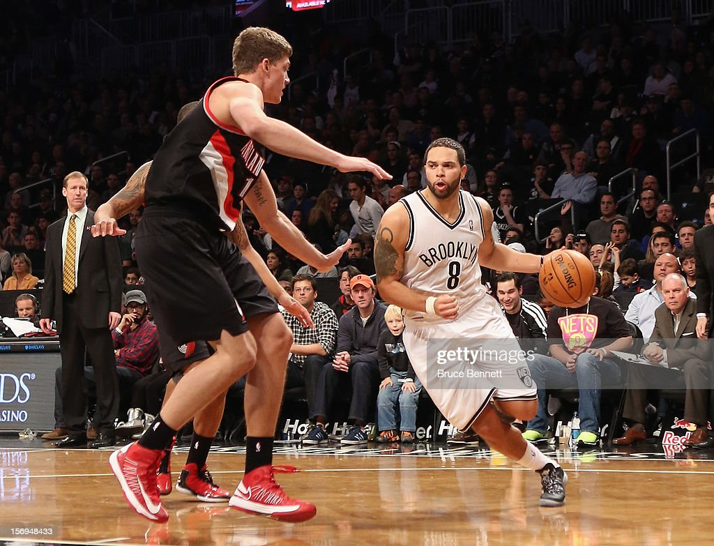 Deron Williams #8 of the Brooklyn Nets dribbles the ball against the Portland Trail Blazers at the Barclays Center on November 25, 2012 in the Brooklyn borough of New York City.
