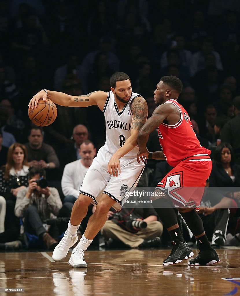 <a gi-track='captionPersonalityLinkClicked' href=/galleries/search?phrase=Deron+Williams&family=editorial&specificpeople=203215 ng-click='$event.stopPropagation()'>Deron Williams</a> #8 of the Brooklyn Nets dribbles the ball against the Chicago Bulls during Game Five of the Eastern Conference Quarterfinals of the 2013 NBA Playoffs at the Barclays Center on April 29, 2013 in New York City.