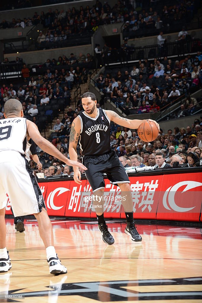 <a gi-track='captionPersonalityLinkClicked' href=/galleries/search?phrase=Deron+Williams&family=editorial&specificpeople=203215 ng-click='$event.stopPropagation()'>Deron Williams</a> #8 of the Brooklyn Nets dribbles the ball up the floor against <a gi-track='captionPersonalityLinkClicked' href=/galleries/search?phrase=Tony+Parker&family=editorial&specificpeople=160952 ng-click='$event.stopPropagation()'>Tony Parker</a> #9 of the San Antonio Spurs on December 31, 2012 at the AT&T Center in San Antonio, Texas.