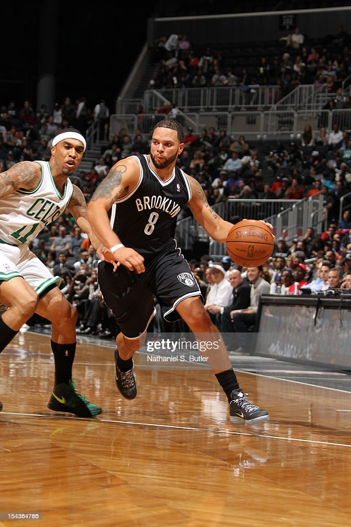 <a gi-track='captionPersonalityLinkClicked' href=/galleries/search?phrase=Deron+Williams&family=editorial&specificpeople=203215 ng-click='$event.stopPropagation()'>Deron Williams</a> #8 of the Brooklyn Nets drives against <a gi-track='captionPersonalityLinkClicked' href=/galleries/search?phrase=Courtney+Lee&family=editorial&specificpeople=730223 ng-click='$event.stopPropagation()'>Courtney Lee</a> #11 of the Boston Celtics during a pre-season game on October 18, 2012 at the Barclays Center in the Brooklyn borough of New York City.