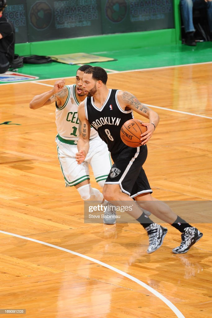 <a gi-track='captionPersonalityLinkClicked' href=/galleries/search?phrase=Deron+Williams&family=editorial&specificpeople=203215 ng-click='$event.stopPropagation()'>Deron Williams</a> #8 of the Brooklyn Nets drives against <a gi-track='captionPersonalityLinkClicked' href=/galleries/search?phrase=Courtney+Lee&family=editorial&specificpeople=730223 ng-click='$event.stopPropagation()'>Courtney Lee</a> #11 of the Boston Celtics on April 10, 2013 at the TD Garden in Boston, Massachusetts.