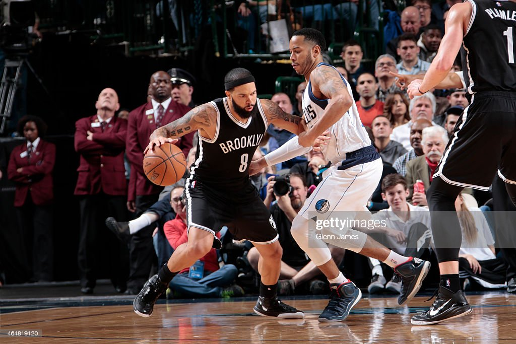 Deron Williams of the Brooklyn Nets drives against Devin Harris of the Dallas Mavericks on February 28 2015 at the American Airlines Center in Dallas...