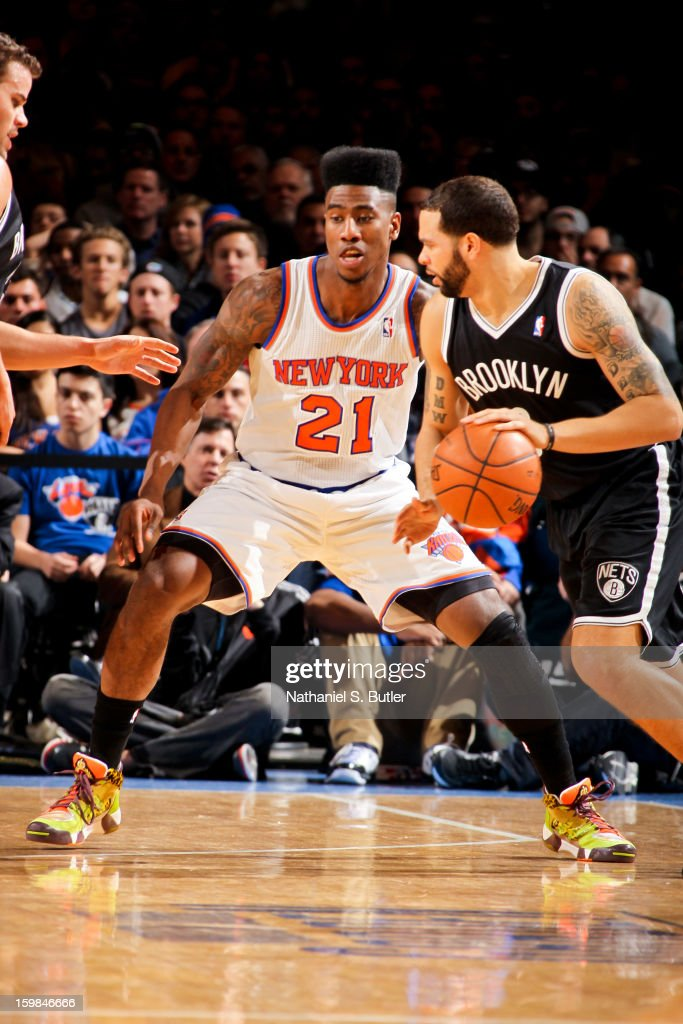 Deron Williams #8 of the Brooklyn Nets drives against Iman Shumpert #21 of the New York Knicks on January 21, 2013 at Madison Square Garden in New York City.