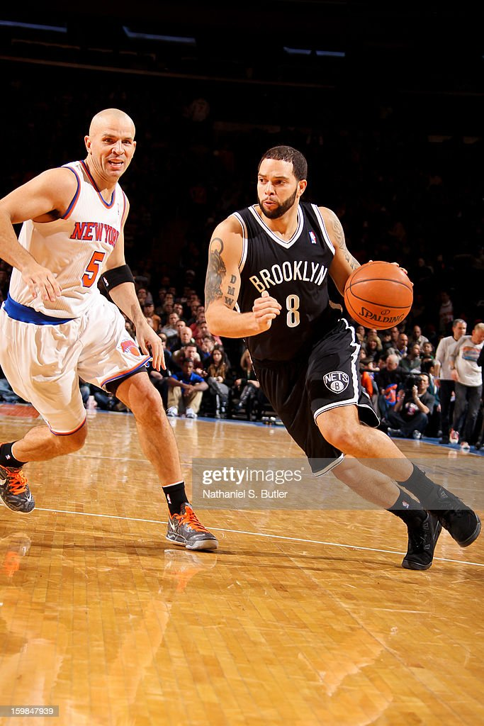 Deron Williams #8 of the Brooklyn Nets drives against Jason Kidd #5 of the New York Knicks on January 21, 2013 at Madison Square Garden in New York City.