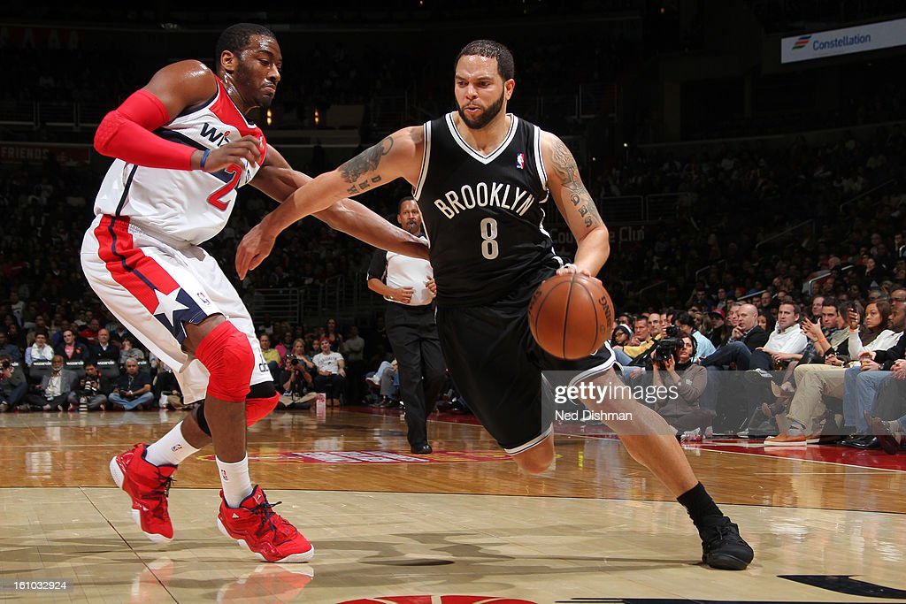 <a gi-track='captionPersonalityLinkClicked' href=/galleries/search?phrase=Deron+Williams&family=editorial&specificpeople=203215 ng-click='$event.stopPropagation()'>Deron Williams</a> #8 of the Brooklyn Nets drives against <a gi-track='captionPersonalityLinkClicked' href=/galleries/search?phrase=John+Wall&family=editorial&specificpeople=2265812 ng-click='$event.stopPropagation()'>John Wall</a> #2 of the Washington Wizards during the game at the Verizon Center on February 8, 2013 in Washington, DC.