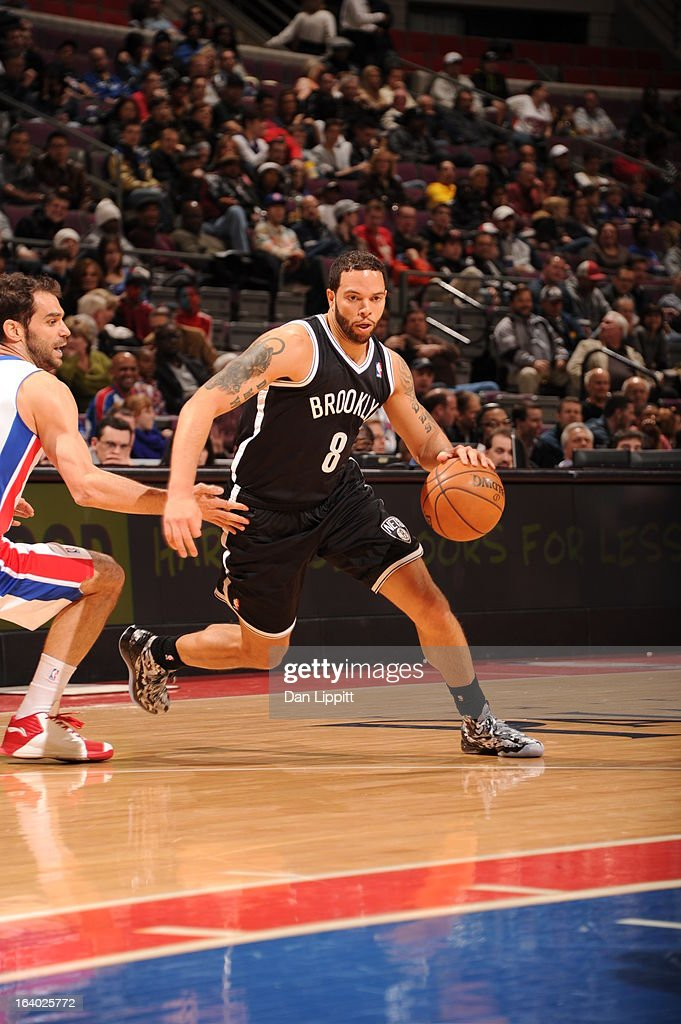 Deron Williams #8 of the Brooklyn Nets drives against Jose Calderon #8 of the Detroit Pistons on March 18, 2013 at The Palace of Auburn Hills in Auburn Hills, Michigan.
