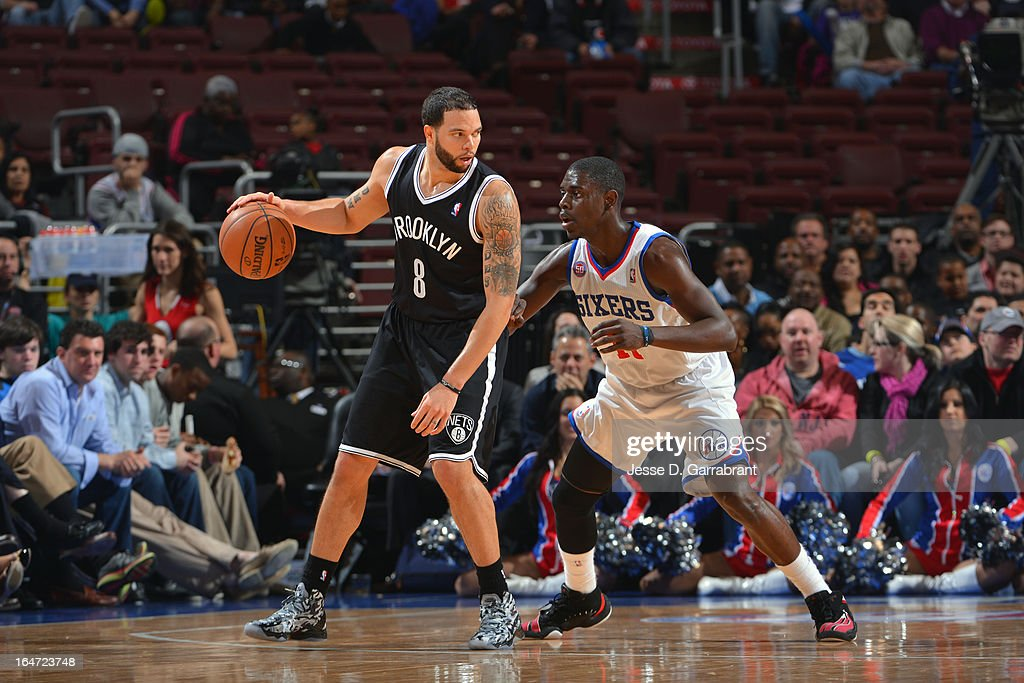 <a gi-track='captionPersonalityLinkClicked' href=/galleries/search?phrase=Deron+Williams&family=editorial&specificpeople=203215 ng-click='$event.stopPropagation()'>Deron Williams</a> #8 of the Brooklyn Nets drives against <a gi-track='captionPersonalityLinkClicked' href=/galleries/search?phrase=Jrue+Holiday&family=editorial&specificpeople=5042484 ng-click='$event.stopPropagation()'>Jrue Holiday</a> #11 of the Philadelphia 76ers at the Wells Fargo Center on March 11, 2013 in Philadelphia, Pennsylvania.