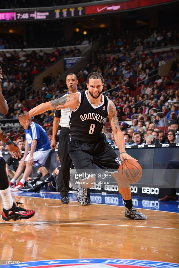Deron Williams #8 of the Brooklyn Nets drives against of the Philadelphia 76ers at the Wells Fargo Center on March 11, 2013 in Philadelphia, Pennsylvania.