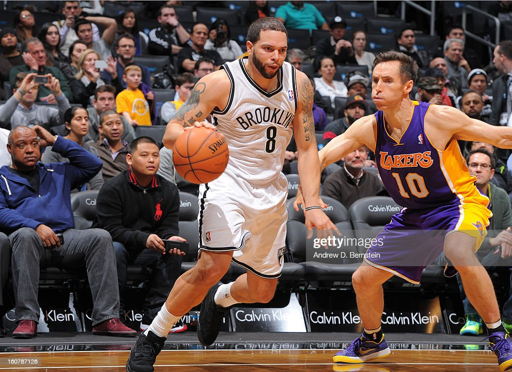 Deron Williams #8 of the Brooklyn Nets drives against Steve Nash #10 of the Los Angeles Lakers on February 5, 2013 at the Barclays Center in the Brooklyn borough of New York City.