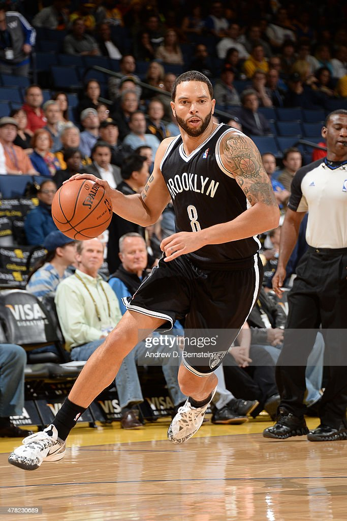 <a gi-track='captionPersonalityLinkClicked' href=/galleries/search?phrase=Deron+Williams&family=editorial&specificpeople=203215 ng-click='$event.stopPropagation()'>Deron Williams</a> #8 of the Brooklyn Nets drives against the Golden State Warriors at Oracle Arena on February 22, 2014 in Oakland, California.