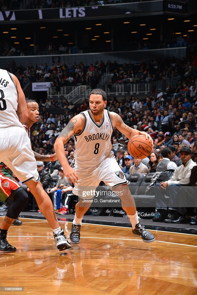 Deron Williams #8 of the Brooklyn Nets drives against the Milwaukee Bucks at the Barclays Center on December 9, 2012 in Brooklyn, New York.