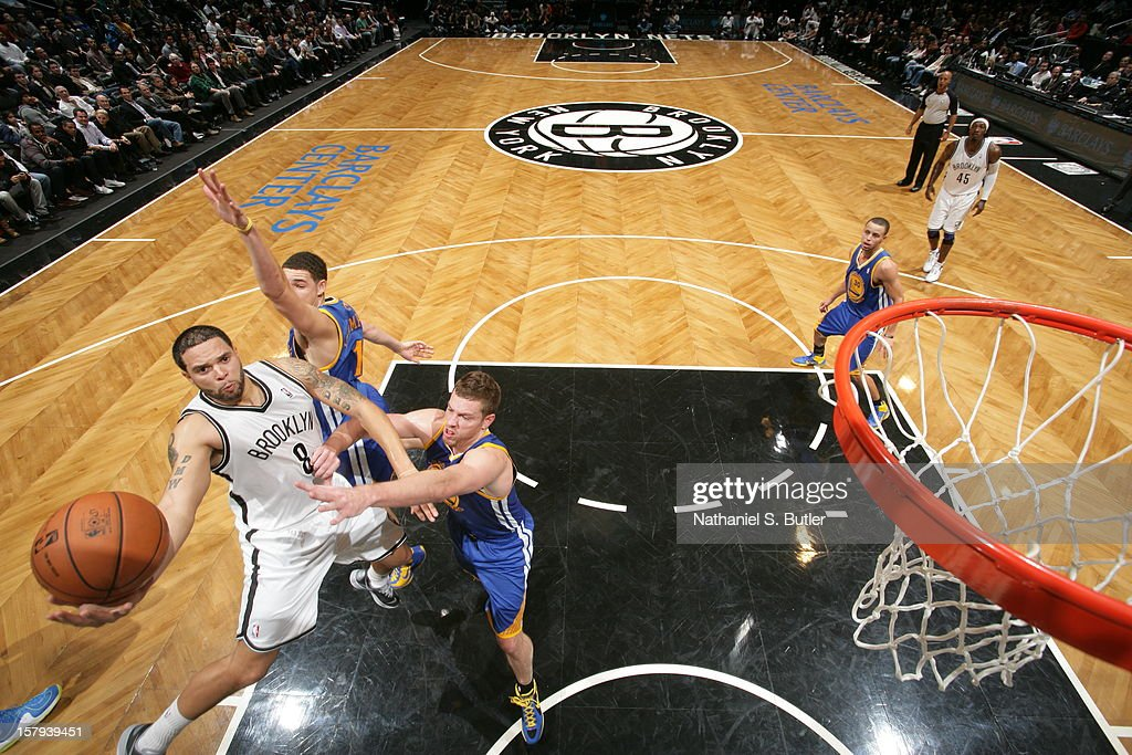 <a gi-track='captionPersonalityLinkClicked' href=/galleries/search?phrase=Deron+Williams&family=editorial&specificpeople=203215 ng-click='$event.stopPropagation()'>Deron Williams</a> #8 of the Brooklyn Nets drives to the basket against David Lee #10 of the Golden State Warriors on December 7, 2012 at the Barclays Center in the Brooklyn Borough of New York City.