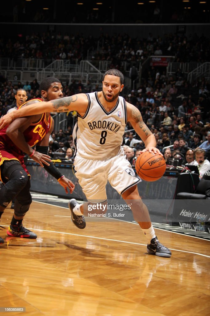 Deron Williams #8 of the Brooklyn Nets drives to the basket against Kyrie Irving #2 of the Cleveland Cavaliers on November 13, 2012 at the Barclays Center in the Brooklyn Borough of New York City.