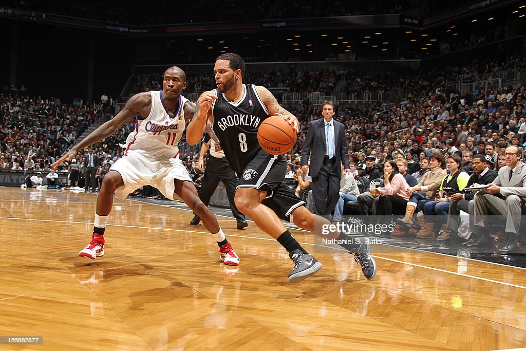 Deron Williams #8 of the Brooklyn Nets drives to the basket against Jordan Crawford #11 of the Los Angeles Clippers on November 23, 2012 at the Barclays Center in the Brooklyn Borough of New York City.